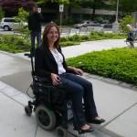 Alex demonstrating a wheelchair