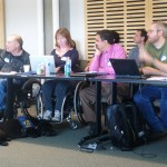 Team members listening to presentations